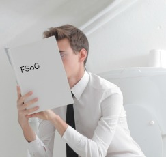 Man Reading on Toilet 2