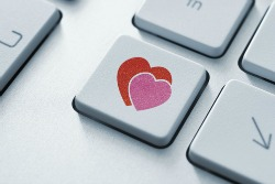 Online love button on the keyboard. Toned Image.